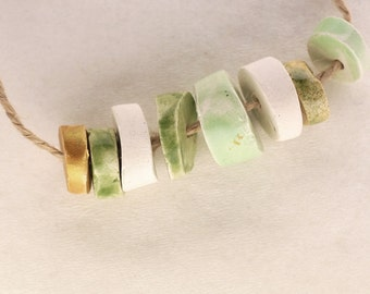 It is enough -- a set of 8 green, white and gold small ceramic beads