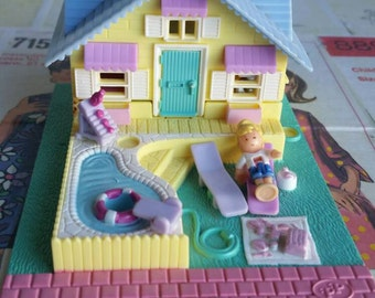 Vintage Miniature Polly Pocket Doll house  and 1 doll
