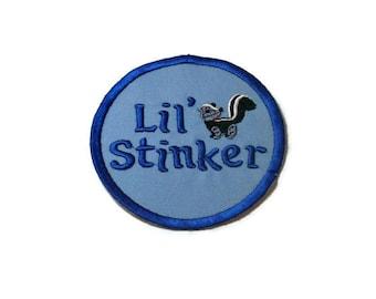 Lil stinker skunk iron on patch