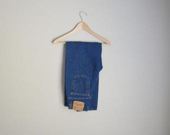 vintage 512 denim medium wash Levi's tapered leg high waisted  womens jeans -- 28x29