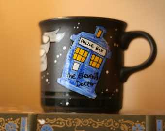"Doctor Who ""We're all stories in the end"" Small, Black, Hand-Painted Ceramic Mug - Eleventh Doctor - Space, stars"