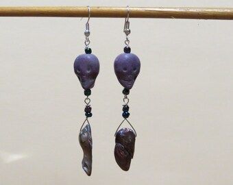 Earrings - Purple double baroque freshwater pearl with ceramic skull and peacock glass beads.    #EAR-031