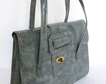 Gray Patent Leather Purse with Top Handles and Buckle Detail Kelly Bag Style
