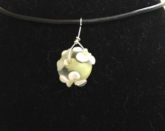 Green flower necklace, leather cord, green lampworked glass bead with white flower