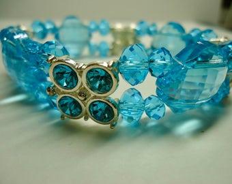 Bracelet, Double Strand Blue Stretchy Swarovski Crystal Bracelet with 4 silver tone connectors and 4 oversized crystals