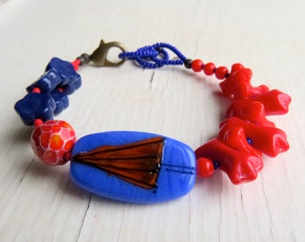 Cats and Dogs - handmade red and blue artisan and vintage bead bracelet with whimsical umbrella focal - Songbead, UK, narrative jewellery