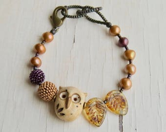 Twilight - handmade earth tone artisan bead bracelet with ceramic owl, handwoven glass and freshwater pearls  - Songbead UK, narrative