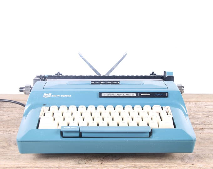 Featured listing image: Vintage Working Electric Typewriter / Smith Corona Teal Sterling Automatic Typewriter / Electronic Typewriter / Retro Typewriter / Old Decor