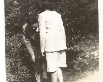 "Vintage Snapshot ""That's Hilarious!"" Man Doubles Over In Laughter Rear Back View Woman Found Photo"
