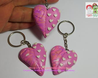 Pink cane half and half with white hearts. Hearts. Keyrings. Key Chains. Handmade from Polymer Clay