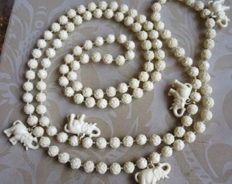 Vintage 1950's ivory celluloid elephant & flower beaded necklace animal Africa charm