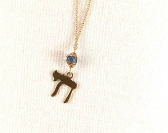 Goldfilled necklace with Chai pendant suspended on blue kyanite gemstone