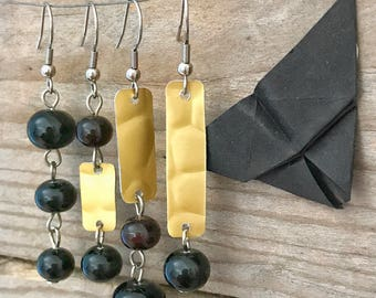 set of four black and golden earrings