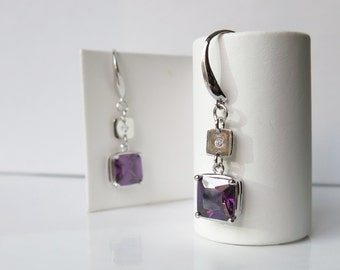 Sterling silver earrings with faceted purple cubic zirconia squares