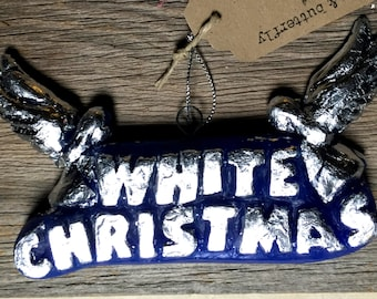 handmade embellished wax ornament for going off the rails on a Christmas train
