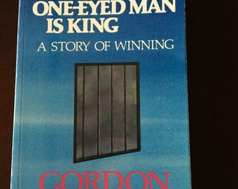 Autographed Book, The One-Eyed Man is King by Gordon Graham.