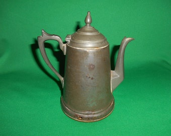 "One (1), Civil War Era, Metalware, Tea Pot, Stamped; ""MANNING"". For Display Purposes Only."