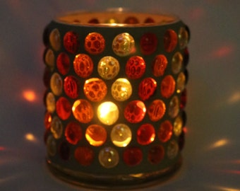 Orange, yellow and red gem mosaic candle holder with tan grout