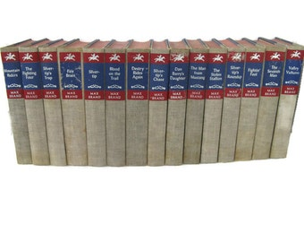 15 matching Max Brand Western cowboy novels in blue,  red, and tan, 1950's.