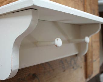 Antique White Shelf With Pegs