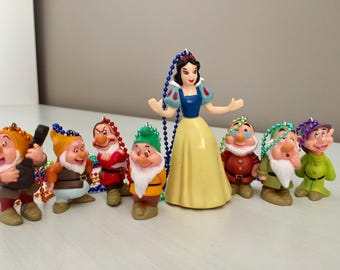 Eight Snow White Themed Necklaces