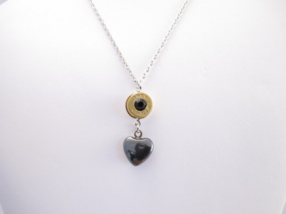 Necklace  9mm Winchester bullet casing with a black crystal center and black heart dangle on base metal chain with heart toggle closure
