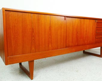 mid century Danish modern teak long low asymmetrical credenza by Kurt Ostervig with slide doors