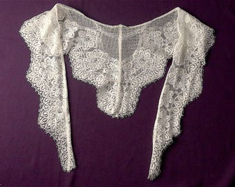 Lace fichu, vintage.  Floral with a high sheen, machine lace, it is off-white rayon, & as soft as silk. c1930s.