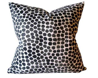 Pillow Cover Dark Spots on Tan