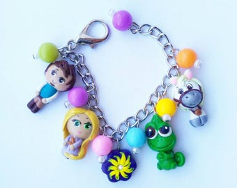 tangled charm bracelet with rapunzel, pascal, flynn rider, maximus and sun