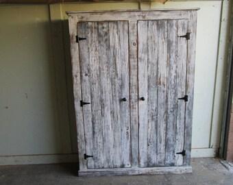 Reclaimed wood two door cabinet with ajustable shelves