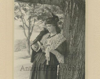 Woman with mandolin by tree antique art photo