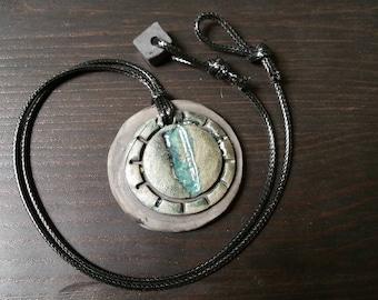 Blue Grey 1.75 inch diameter Ceramic Raku Circle Sun Pattern Pendant Necklace on 1.5mm Waxed Cord  20 inches with Raku Bead Loop Clasp
