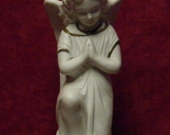 antique German porcelain bisque angel with wings ,kneeling and praying.