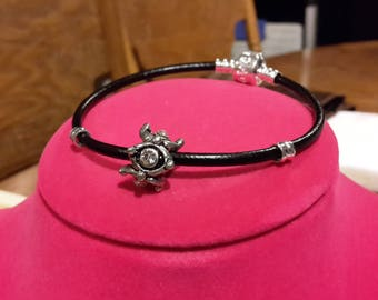 Black leather charm bracelet