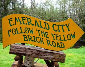 Wizard of OZ fantasy sign, EMERALD CITY, follow the yellow brick road. Wavy emerald letters hand-carved, routed & painted with gloss finish