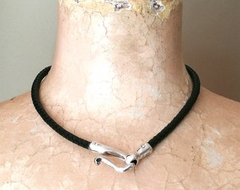 Sterling Silver Scroll Necklace plaited leather.