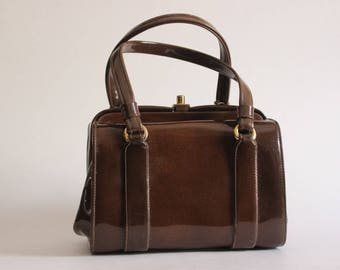 Vintage chocolate brown patent leather purse with push lock closure