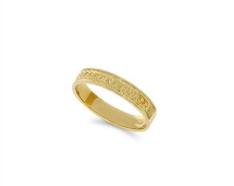14k solid gold 3.5mm wide beaded look wedding band.