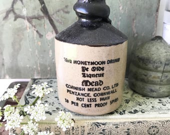A vintage stoneware crock Honeymoon Mead with original contents