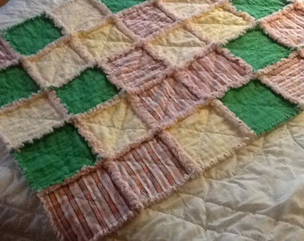 Pinks, greens and yellow baby flannel rag quilt
