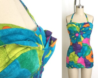 vintage 1950s swimsuit | 50s petal bust playsuit with a colourful print