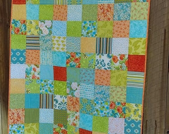 Pretty baby quilt handmade in greens, aqua, oranges, yellow, peach, white,  makes a wonderful gift for the mom-to-be!
