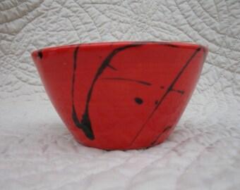 Red bowl with black splatter print