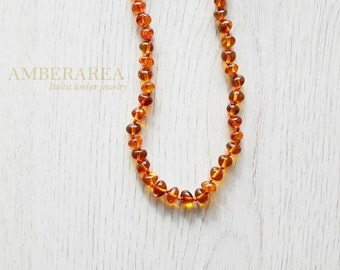 Baltic amber baroque necklace for adults. ~46 cm long necklace. Natural polished amber beads. Knotted each beads. 6079