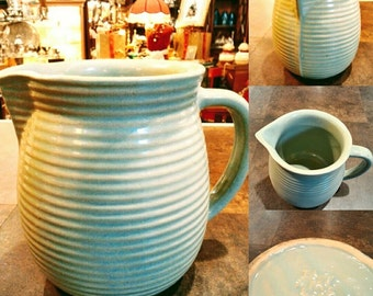 Vintage 1930's stone ware pitcher a made by Monmouth Pottery Co.