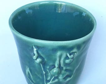 Cup with Cast Rose Hip Design