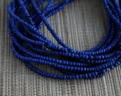 2-3mm Cobalt Blue Coconut Shell Pucalet Rondelle Beads Dyed and Waxed 15 inch strand