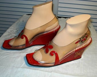 Vintage 60s to 70s Galano clear plastic heels in good wearable condition. Red heels with buterfly design.