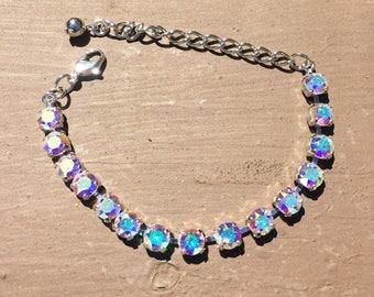 Stunning 15 box Swarovski Crystal bracelet in a rhodium setting and 6mm Crystal Aurora borealis Swarovski Crystals.
